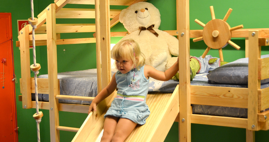 Double bunk bed with slide, rope and rudder
